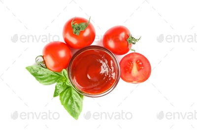 Fresh cherry tomatoes with basil and souce isolated on white background, top view. Ripe vegetables