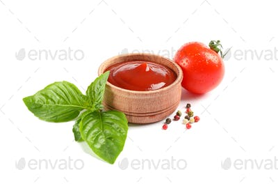Fresh cherry tomato with basil, souce and spices isolated on white background. Ripe vegetables