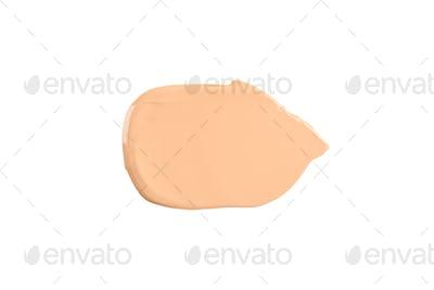 Liquid foundation smudge isolated on white background