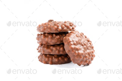 Stack of chocolate cookies with caramel filling isolated on white background