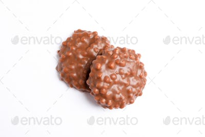 Chocolate cookies with caramel filling on white background