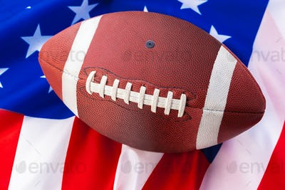 American football on American old glory flag