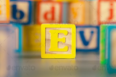 Photograph of colorful Wooden Block Letter E