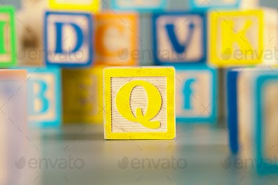 Photograph of colorful Wooden Block Letter Q