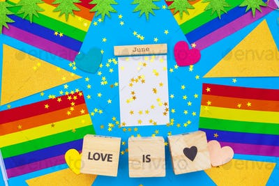 Gay pride flag on wooden table. creative photo
