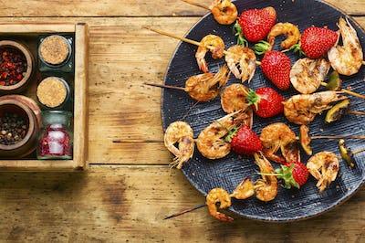 Grilled shrimps on skewers with strawberries,BBQ shrimp