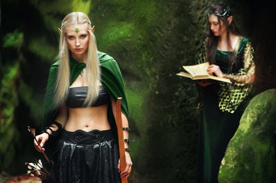 Two female elves walking in the woods