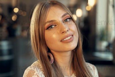 Beautiful female model portrait in a cafe