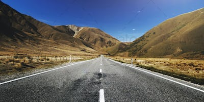 Highway road with mountain range background free image
