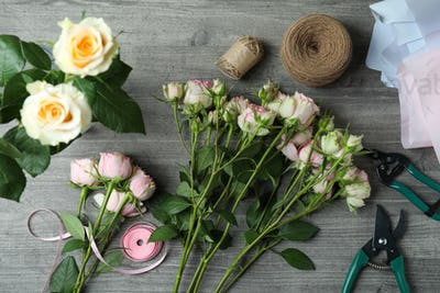 Florist concept with roses on gray textured background