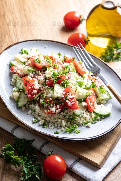 Traditional oriental salad Tabouleh. Tabule cous cous salad