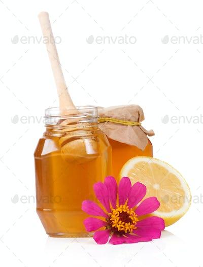 lemon, flower and honey isolated on white