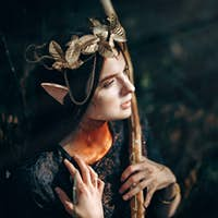 beautiful elf woman fabulous, fairy forest, famtasy young woman with long ears, long dark hair