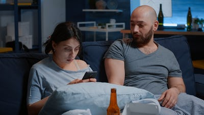 Shocked worried couple feeling stressed about eviction notice