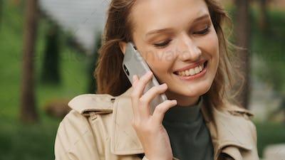 Portrait of beautiful student girl talking with boyfriend on sma