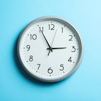 Big beautiful clock on blue background, space for text