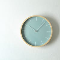 Big beautiful stylish clock hanging on light background, space for text
