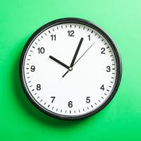 Big beautiful office clock on green background, space for text