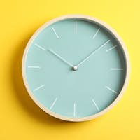 Big beautiful stylish clock on yellow background, space for text