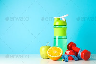 Loss weight accessories on white table against blue background
