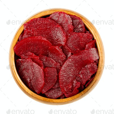 Sliced pickled beetroot slices, cooked red beets, in a wooden bowl