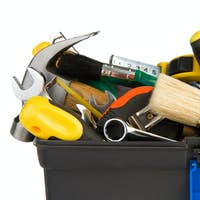 tools and instruments in black plastic box