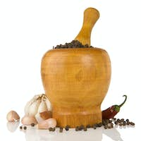 garlic, onion and pepper in mortar and pestle