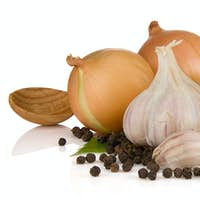 garlics, pepper and onion isolated on white