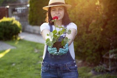 Woman holding plant, shallow dof