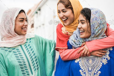 Young islamic people having fun outdoor in the city - Main focus on center woman face