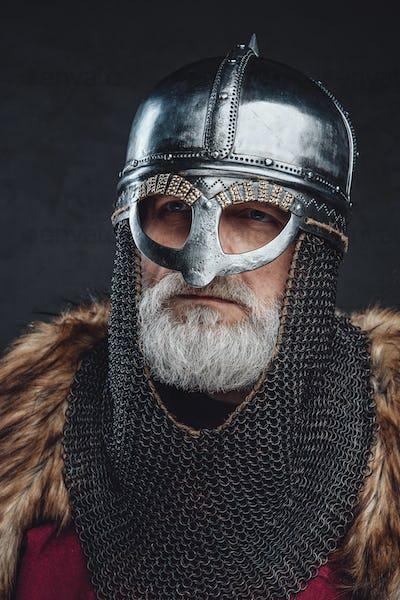 Headshot of medieval elder knight wearing helmet
