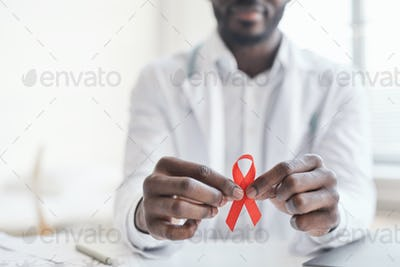 Doctor with ribbon at hospital