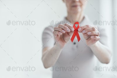 Patient with red ribbon