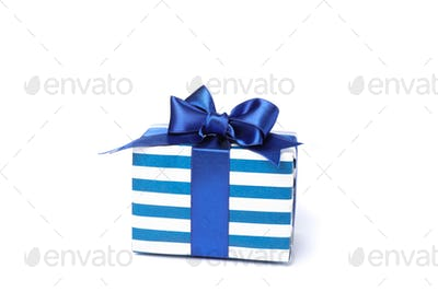 Beautiful gift box with bow isolated on white background