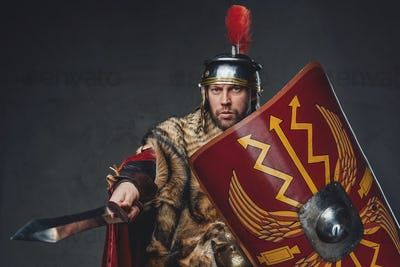 Roman general with shield pointing his sword