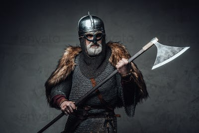 Studio shot of antique old age viking with axe
