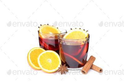 Glasses of tasty mulled wine with orange isolated on white background
