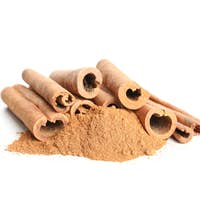 Cinnamon sticks and powder isolated on white background. Sweet spice