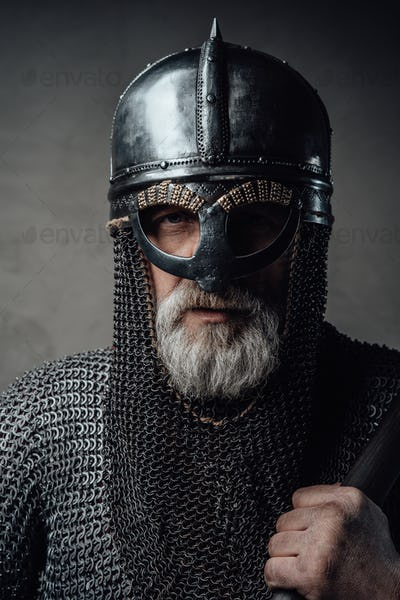Headshot of barbaric nordic warrior against gray background