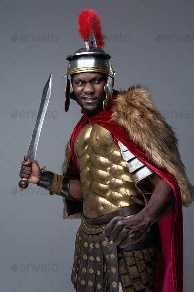 Offensive roman soldier of african ethnic with gladius