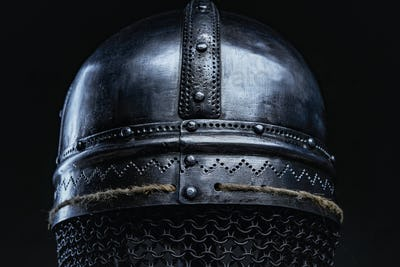 Back view of antique steel helmet in dark background