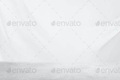 Plain white product background with a concrete floor