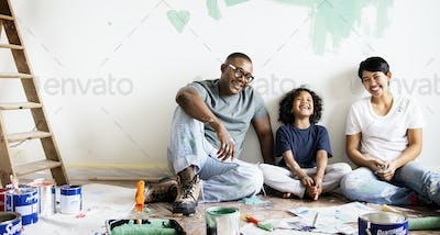 Black family painting house wall for interior design