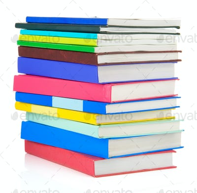 pile of new books isolated on white