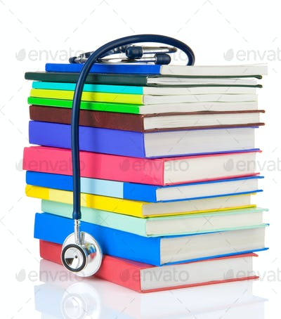stethoscope and pile of books isolated on white