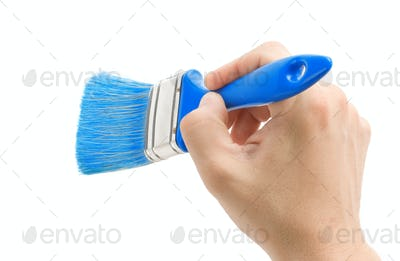hand and brush isolated on white