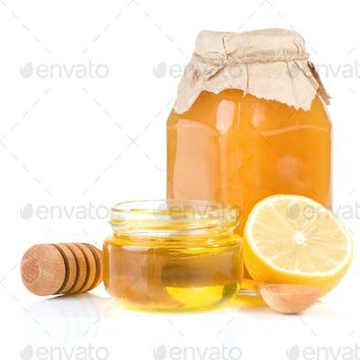 jar full of honey and lemon on white