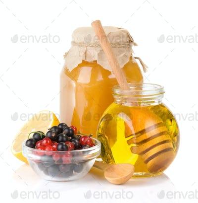 glass jar full of honey and berry