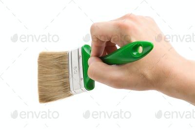 hand and paint brush