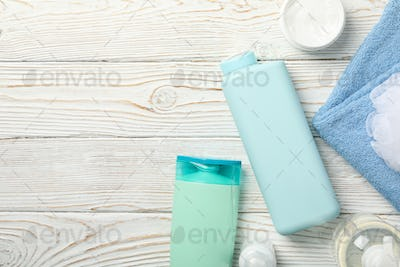 Composition with body care products on wooden background, top view